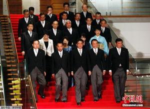 日本首相安倍即将改组内阁主要阁僚将留任
