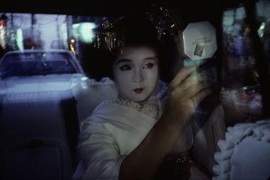 揭秘日本红唇艺妓的前世今生[组图]。