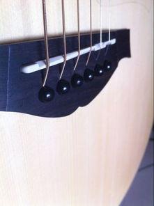 电吉他用力弹6弦有点大品