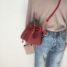 手提包怎么和衣服搭配